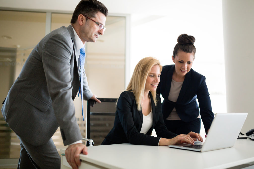 Picture of sales agents working together in office